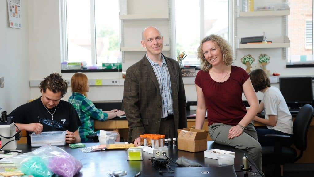 Public science leaders Holly Menninger and Rob Dunn in lab with students