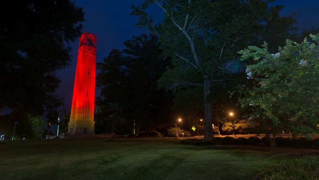 Belltower lit up red at night