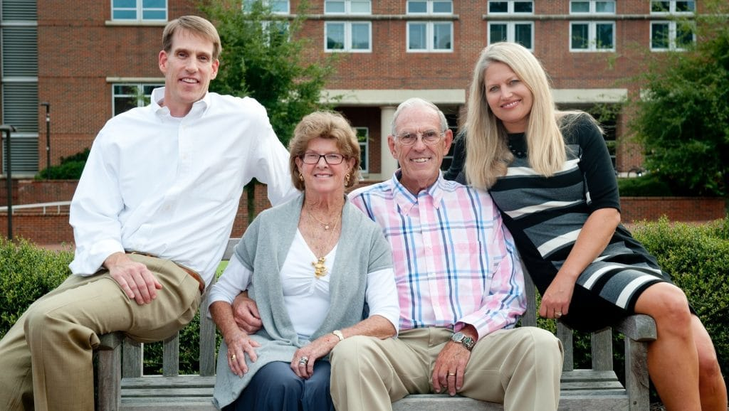 Multi-generational family portrait of College supporters