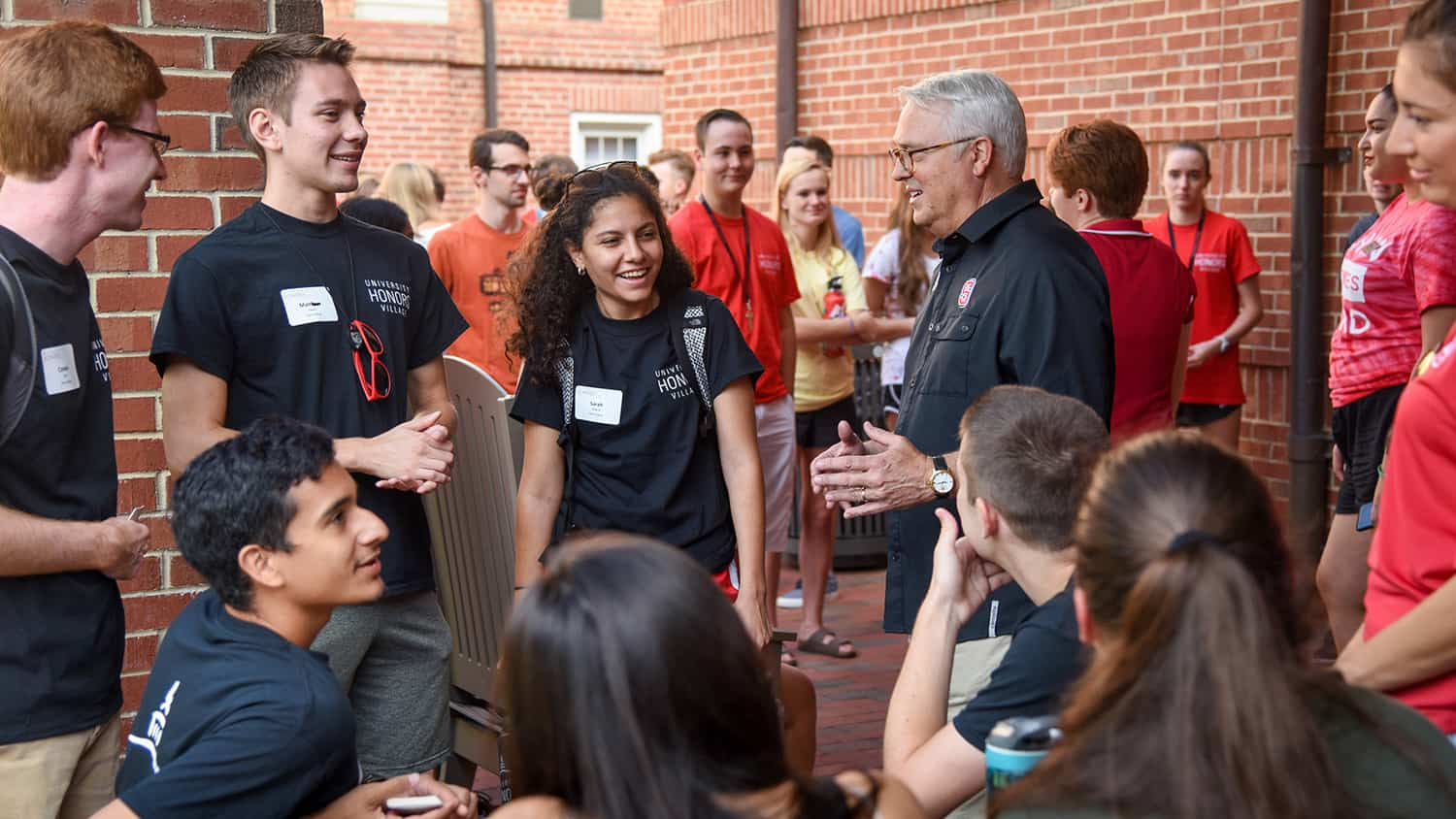 Chancellor Randy Woodson talks with NC State students during move-in