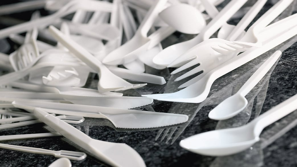 Disposable plastic utensils on a countertop