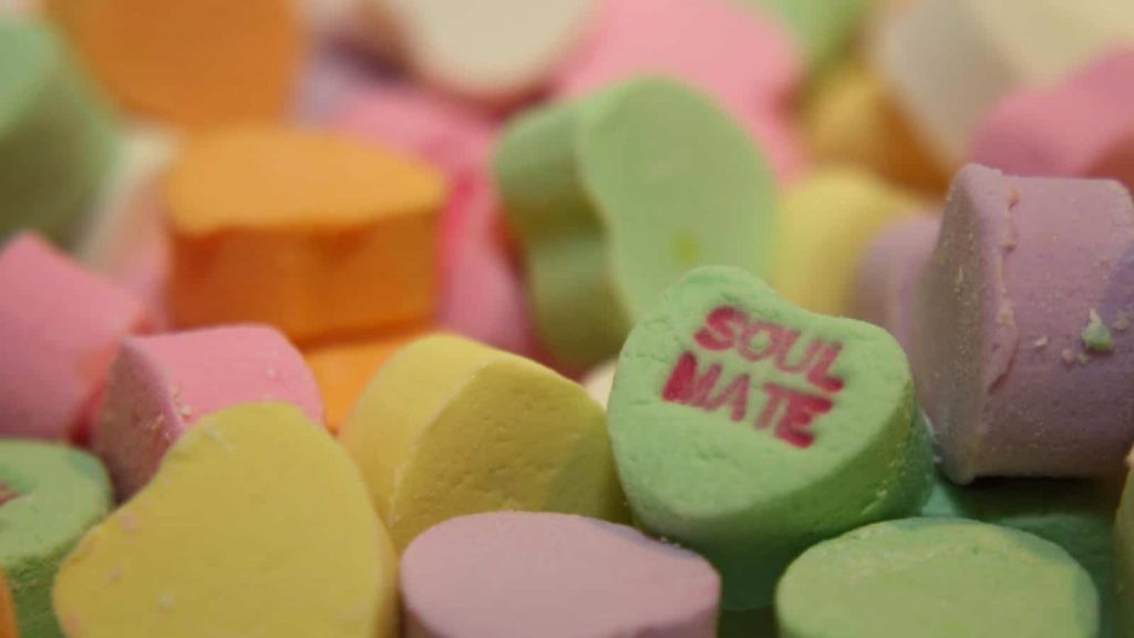Candy hearts with one reading Soul Mate at the forefront
