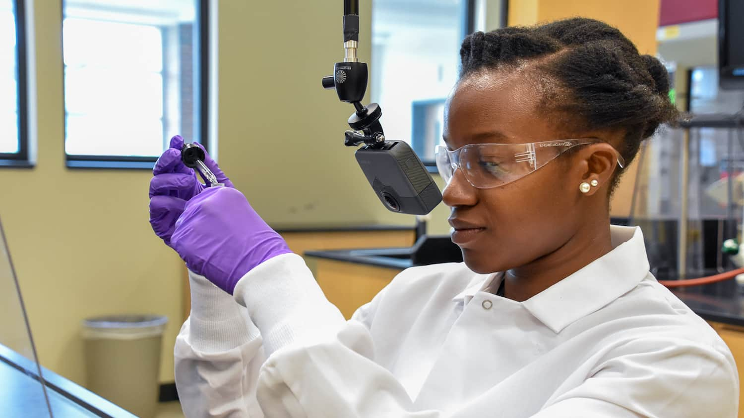 Teaching Assistant Lyniesha Wright during a test shoot of the organic chemistry virtual reality labs. The placement of the GoPro Fusion 360° camera gives the experience a first-person point of view.