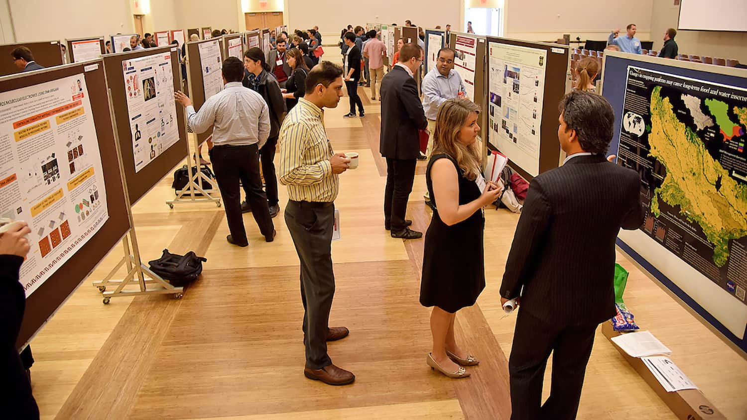 Students and attendees at a research symposium on campus
