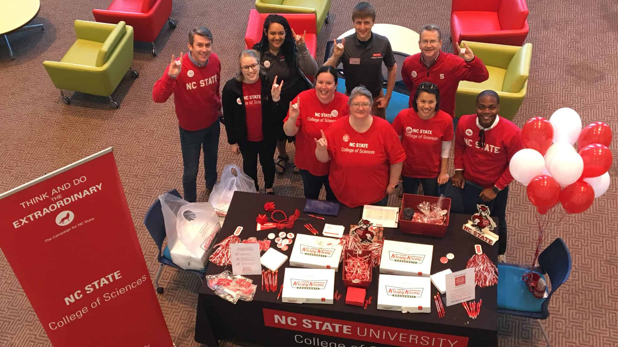 Students and staff gather at a Day of Giving event