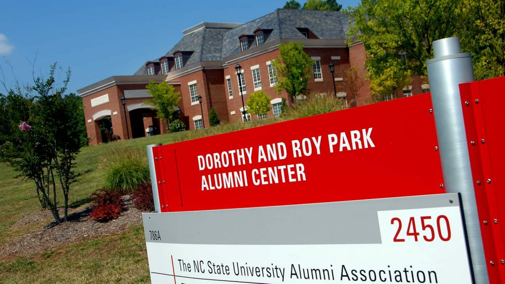 Park Alumni Center, with sign in the foreground.