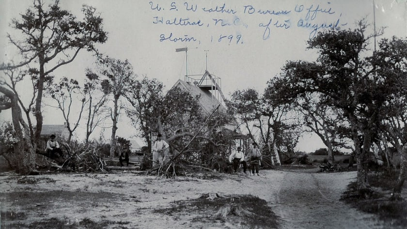 A historical photograph of the Hatteras Weather Bureau after a 1899 hurricane