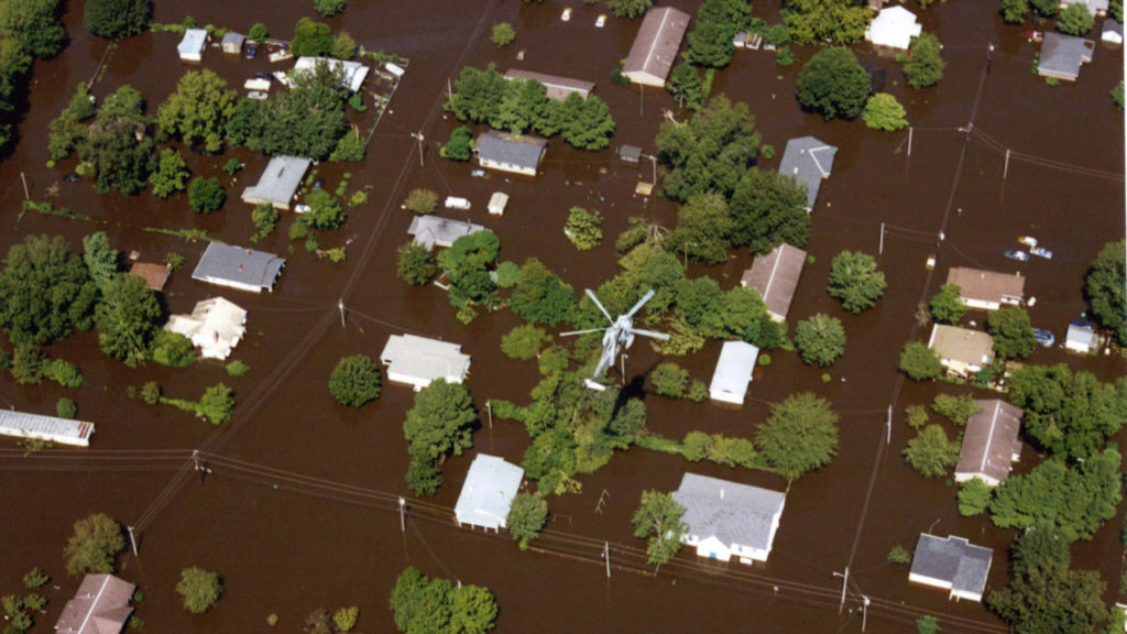 A helicopter flies over flooding in Edgecombe County. (Photo by Dave Saville/FEMA)
