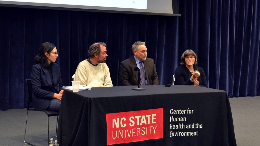 Four panelists sit behind a table with a NC State University Center for Human Health and the Environment banner