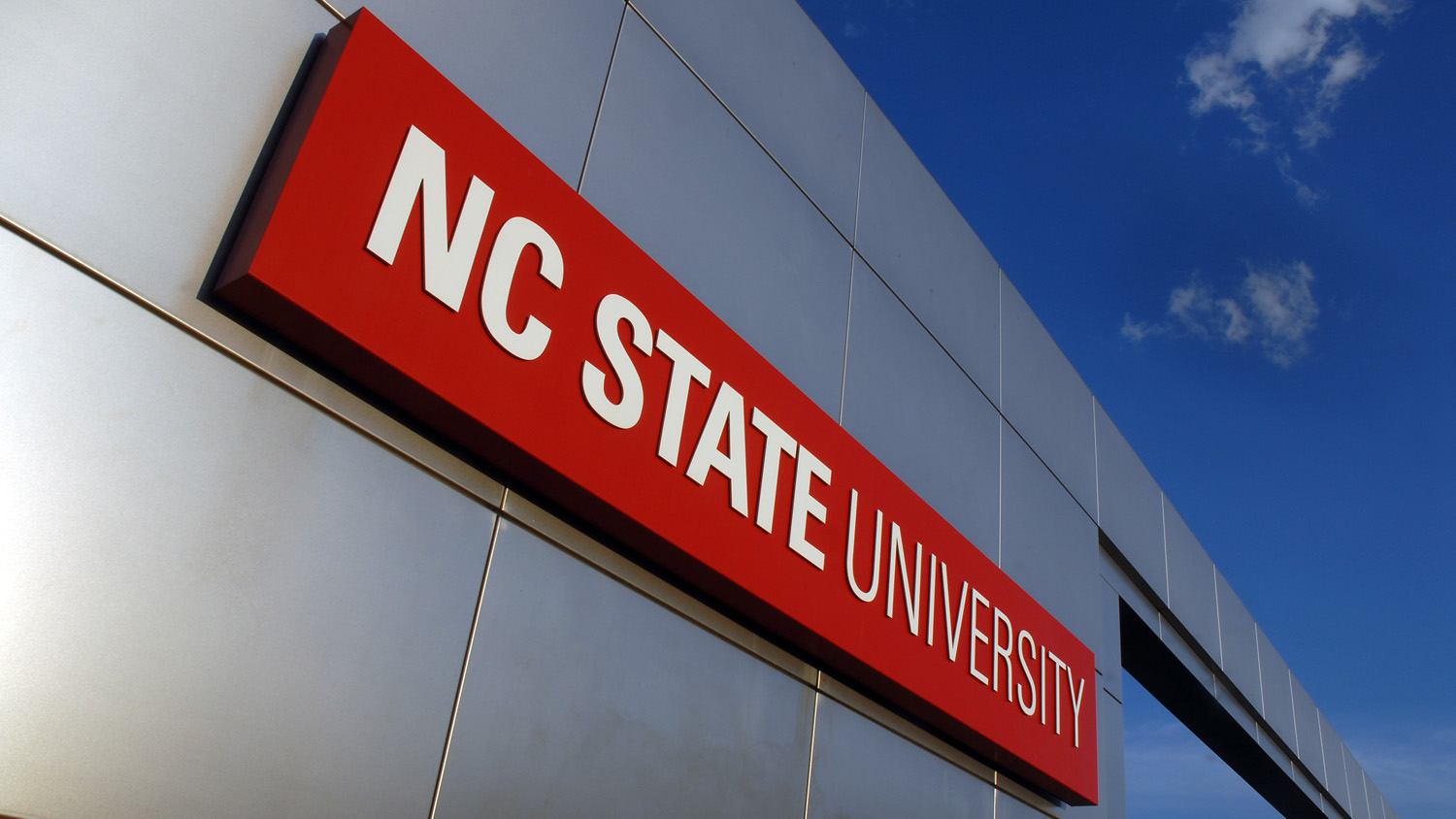 Campus gateway sign that reads NC State University