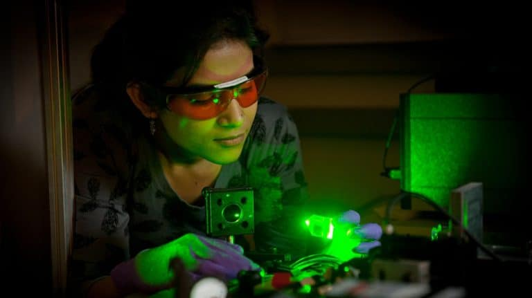 Student working with lasers