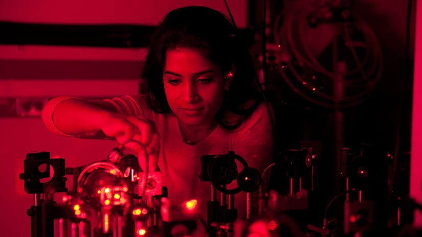 Student working with lasers in lab