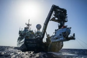 The research vessel Atlantis with the submersible Alvin hanging off its stern. Photo credit: Luis Lamar, Woods Hood Oceanographic Institution.