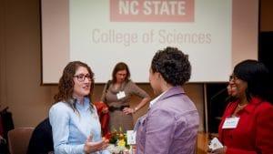 Christina Koch greeting students