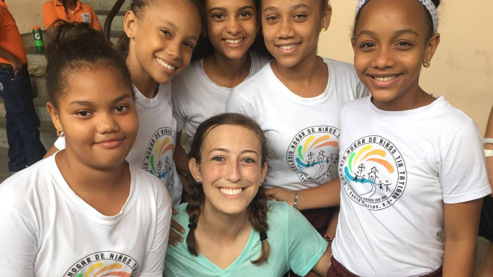 Haley Newton with kids in the Dominican Republic