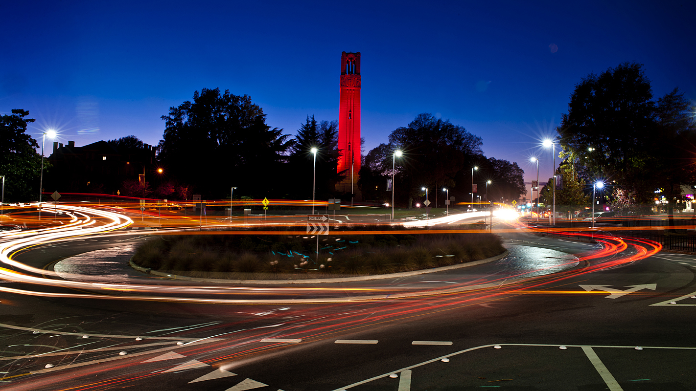 NC State Belltower lit red at night