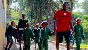 Senior Nicholas Lacy with kids during a service trip to Kenya