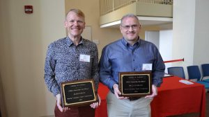 Alan Porch and Wall Crumpler holding their Awards for Excellence plaques