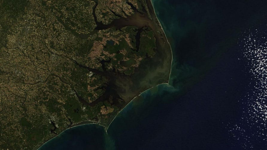 A map of the coast of North Carolina indicating organic matter washed into Pamlico Sound by Hurricane Matthew. Credit: NASA Terra/MODIS visualized using Zoom Earth