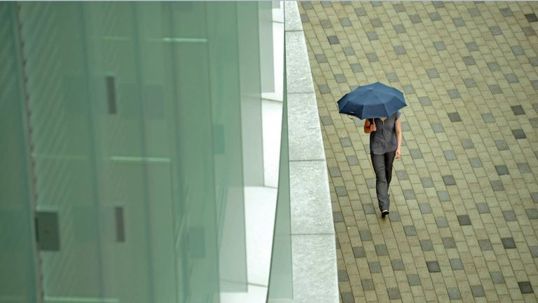 Student walks to Talley Student Union in the rain.