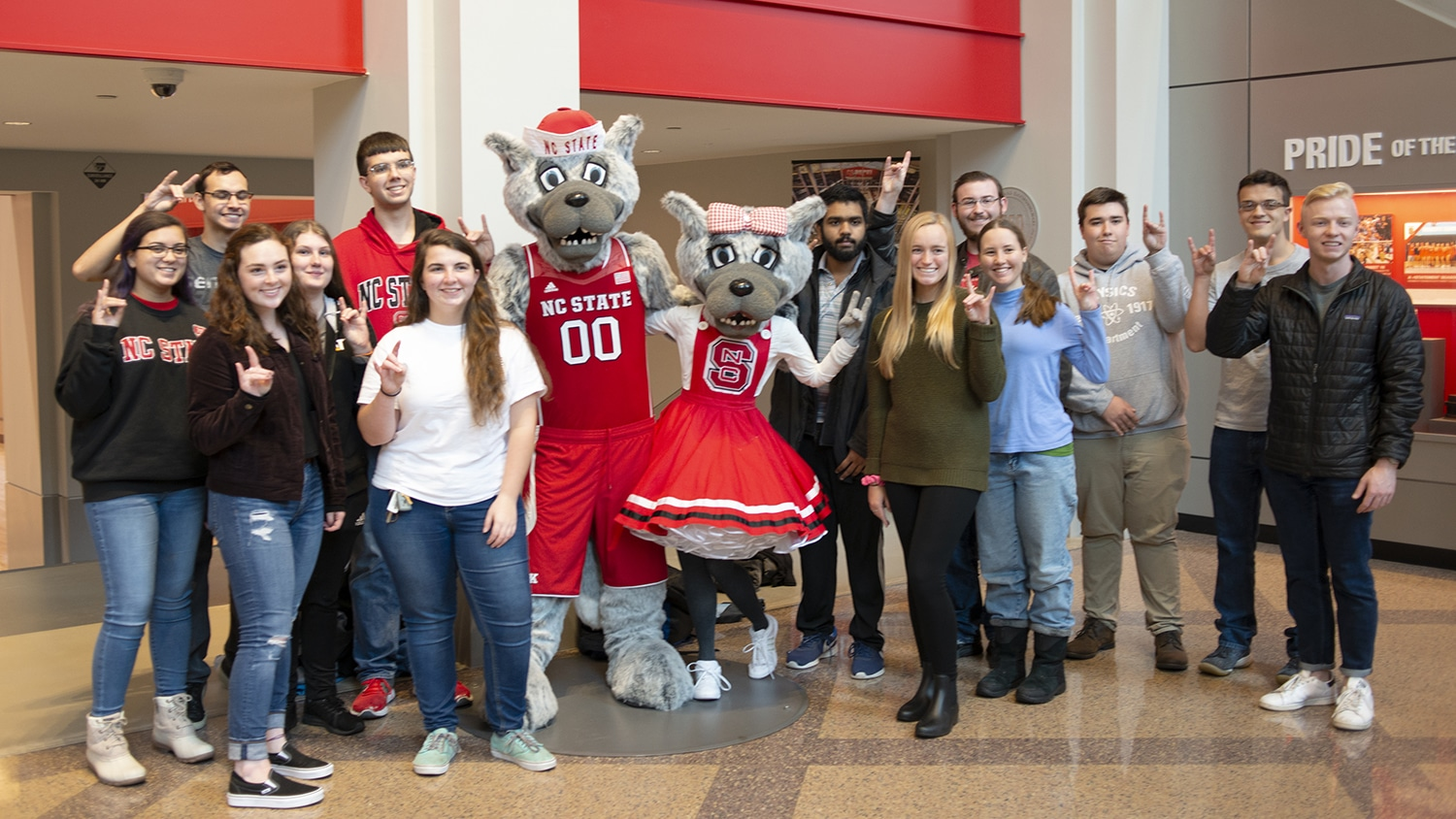 The Solomon Scholars pose with Mr. and Ms. Wuf in Reynolds Coliseum