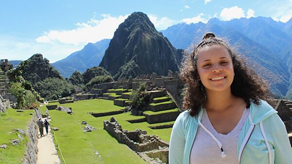 Jonina Wrenn in front of mountains in Peru