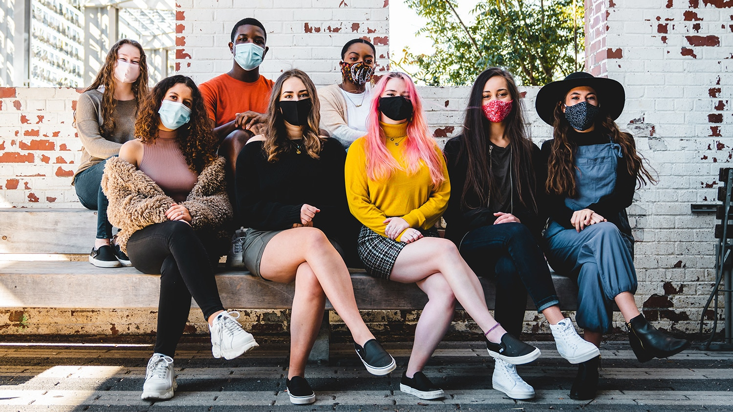 A group photo of 8 students from Fusion Dance Crew wearing protective face masks