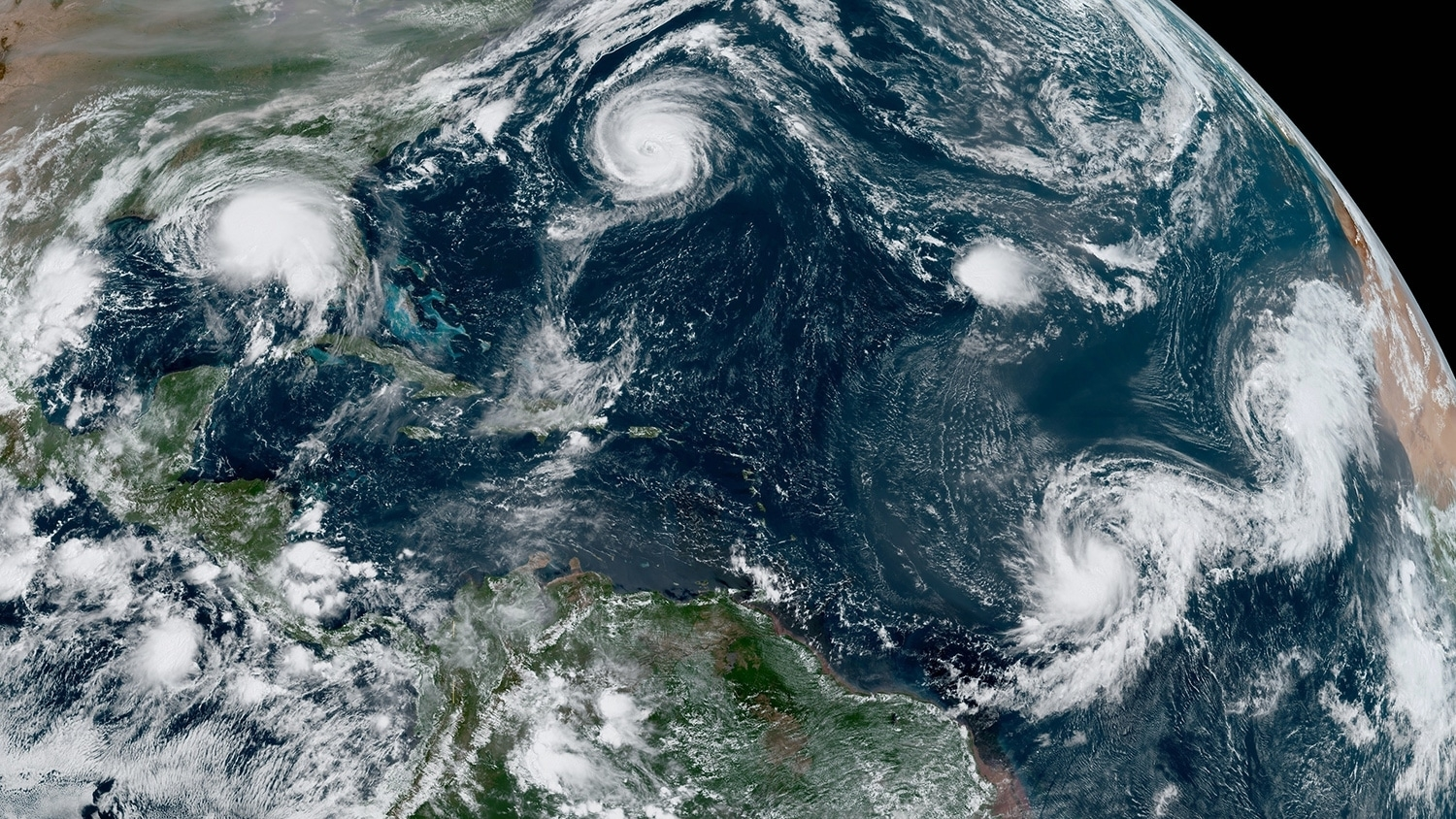 A satellite image of the North Atlantic with 5 active hurricanes on September 14.