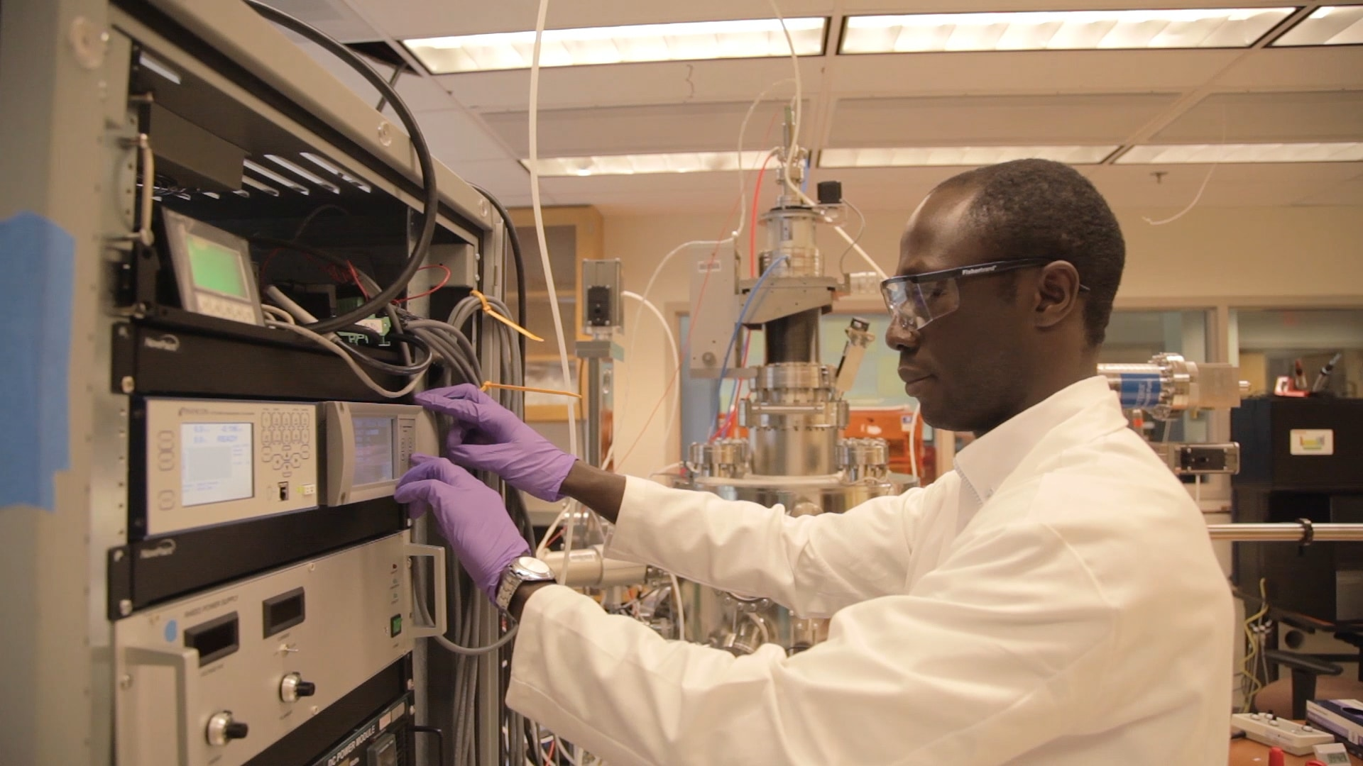 Divine Kumah works with equipment in his lab