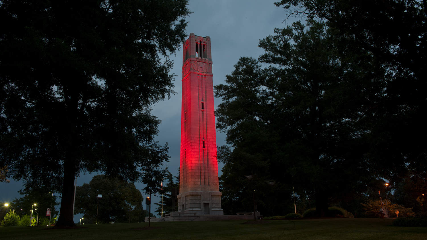 NC State Belltower lit red