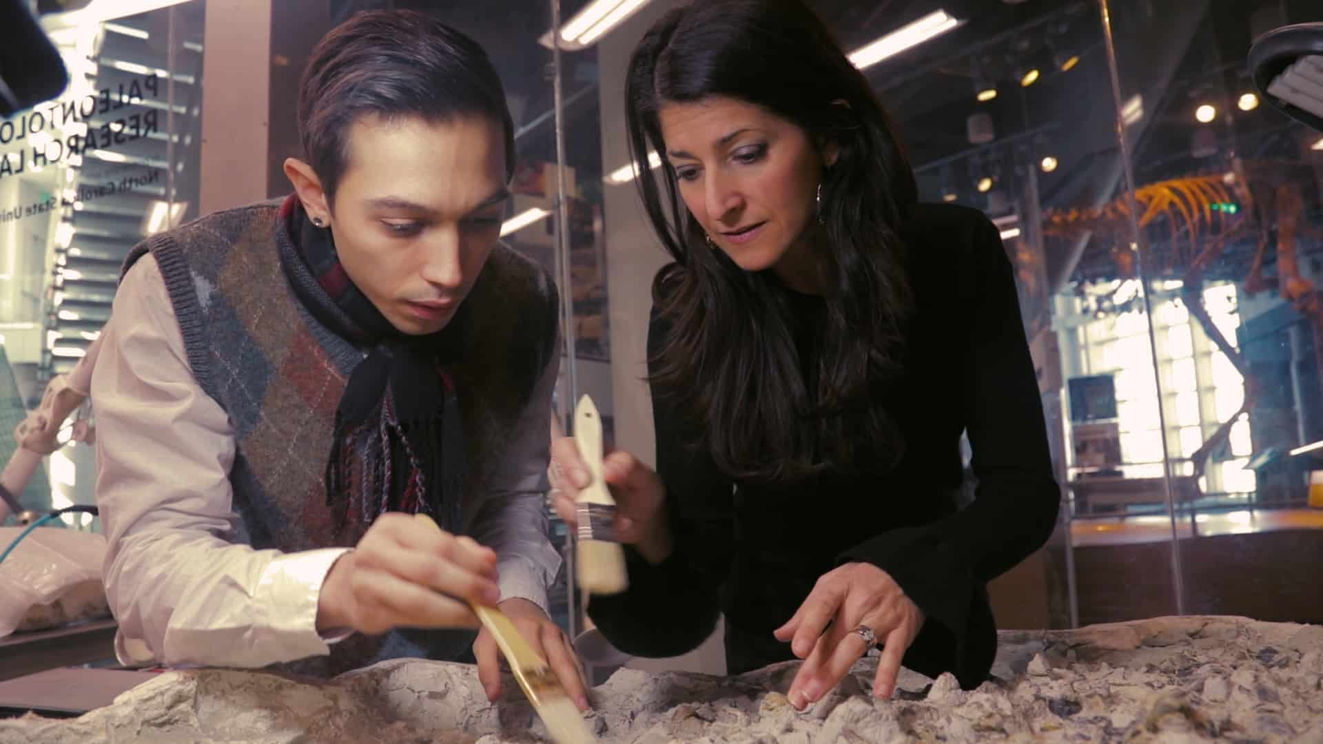 Paleontologist Lindsay Zanno works with a student in her lab