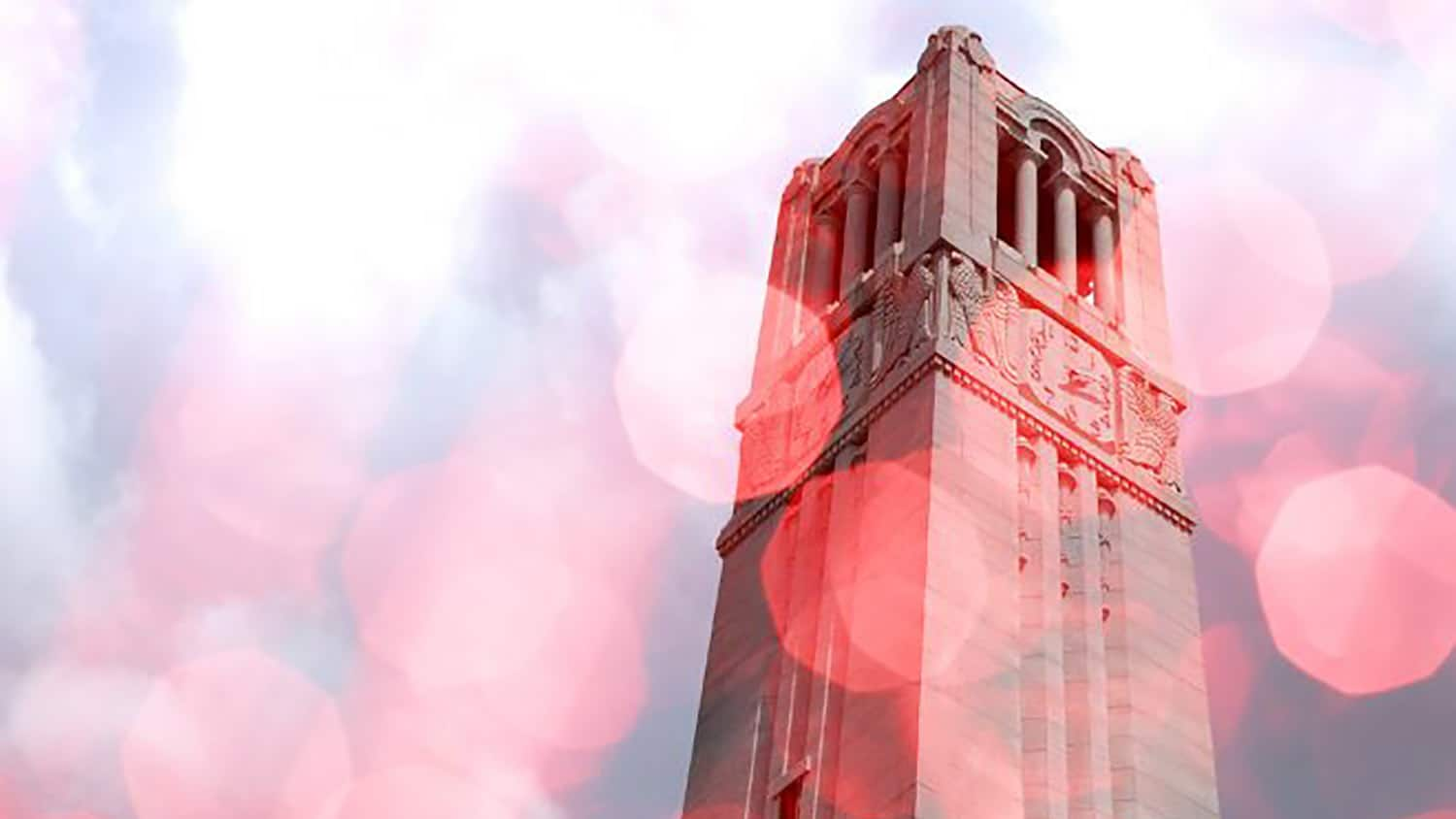 NC State belltower with a red filter