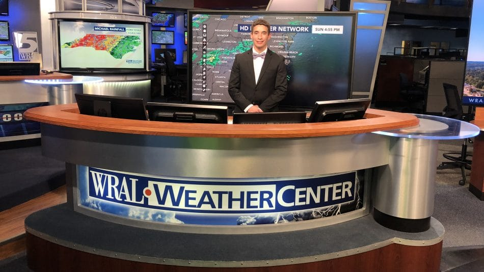 Clay Chaney behind the desk in the WRAL Weather Center